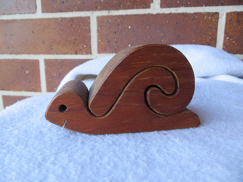smiling snail, wooden