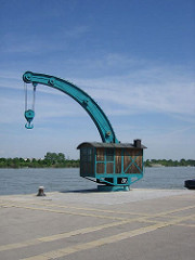 a shipping crane by the water