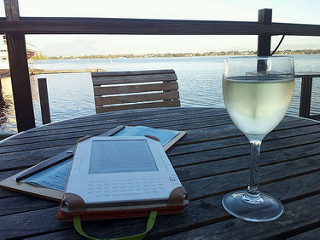 ereader, a glass of wine. By the river. Perth.