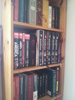 nicely bound books on a shelf